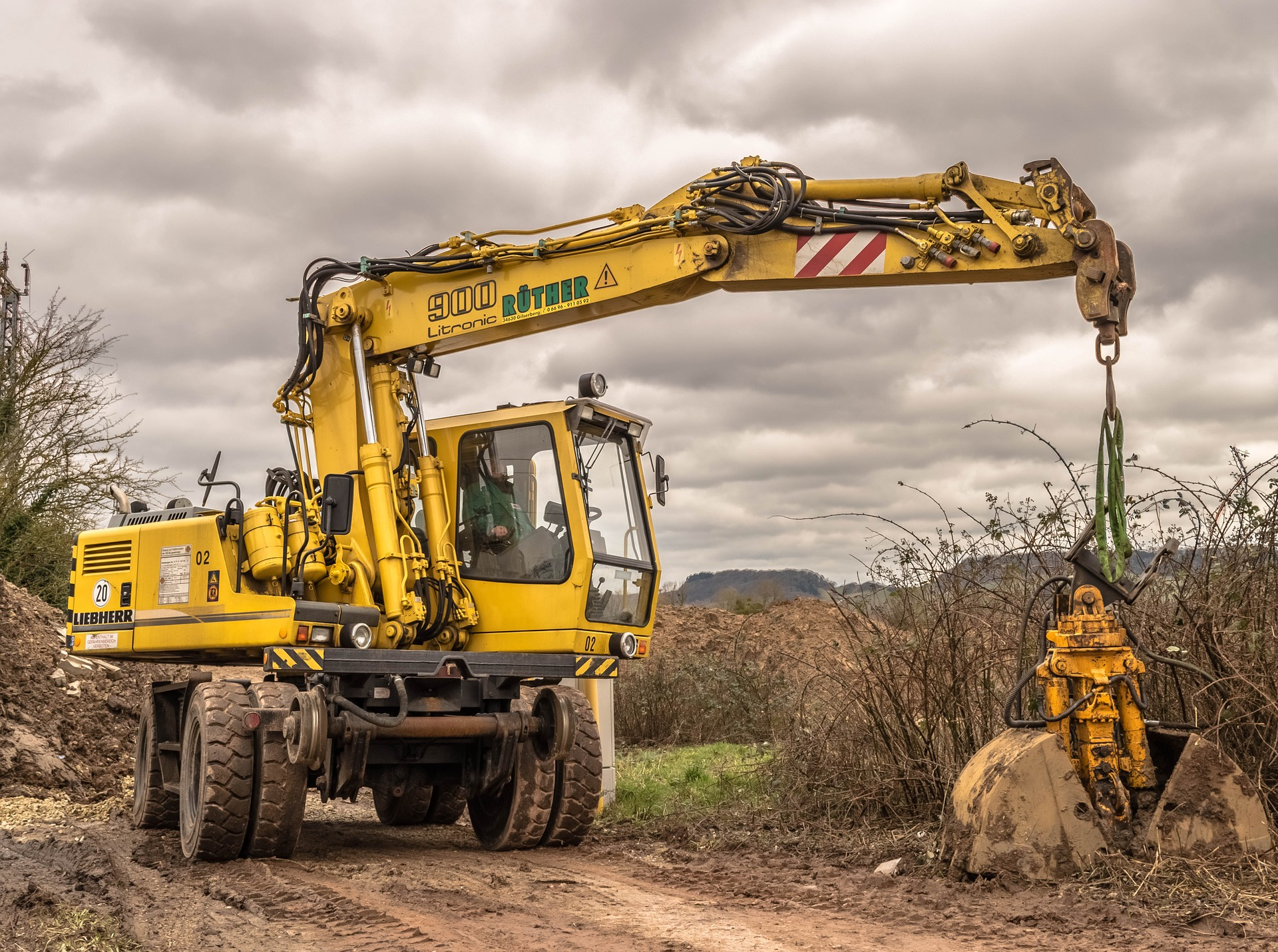 Excavator and backhoe Hauling and Transportation Services